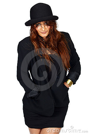 Latin woman in black jacket and hat.
