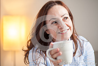 Latin woman drinking coffee