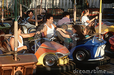 Latino family in bumper cars Editorial Stock Photo