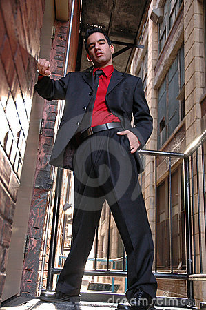 Latino guy in red shirt black