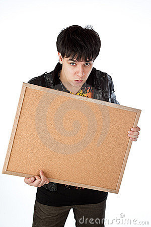 Latino man holding a cork bulletin board