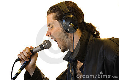 Latino Rock Star Shouting in a Microphone