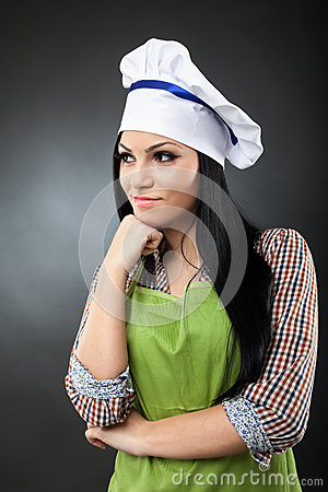 Latino woman cook thinking