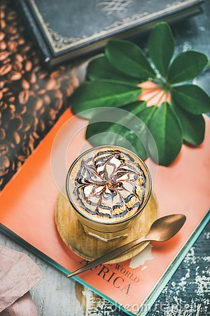 Free Latte Coffee With Chocolate Sauce Pattern In Tall Glass Royalty Free Stock Image - 127346536