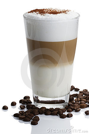 Latte macchiato with cocoa and beans on white