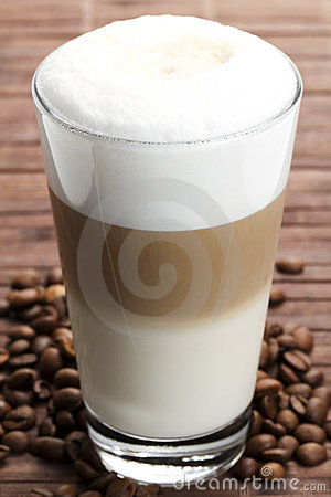 Latte macchiato with coffee beans