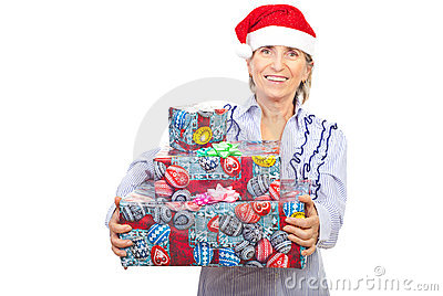 Laughing aged woman holding Christmas presents