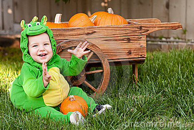 Laughing baby in dragon Halloween costume