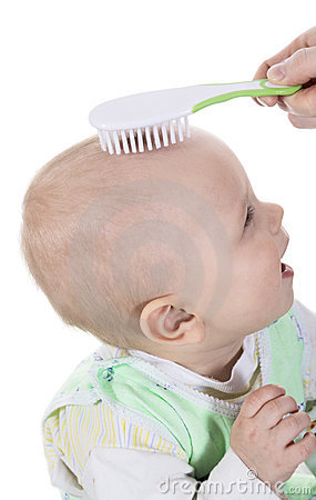 Laughing baby with hairbrush