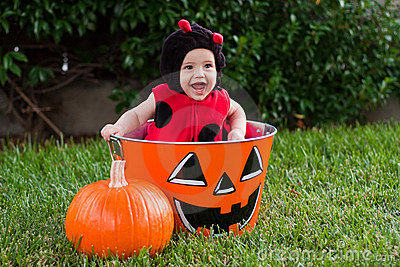 Laughing baby in ladybug Halloween costume