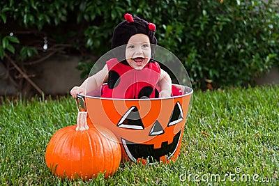 Laughing baby in ladybug Halloween costume