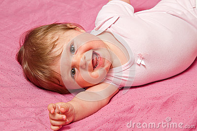 laughing baby looking at camera