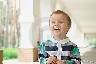 Laughing baby outdoors with copy space