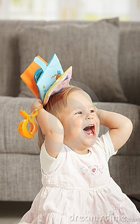 Laughing babygirl with toy