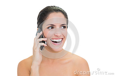 Laughing bare brunette phoning