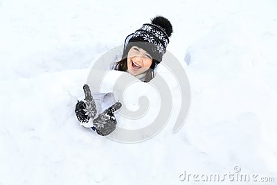 Beautiful girl portrait in winter time with snow.