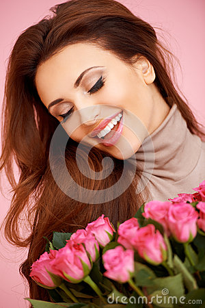 Laughing beautiful woman with roses