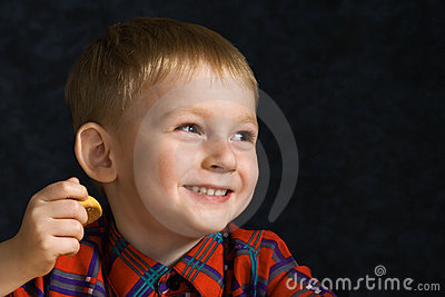 Laughing boy with cookies