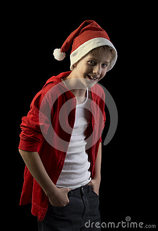 Laughing boy in Santa hat isolated on black background