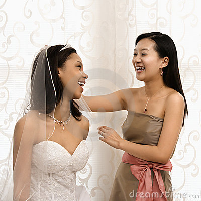 Laughing bride and bridesmaid.