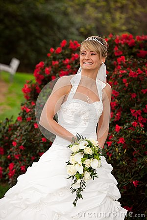 Laughing bride funny red roses