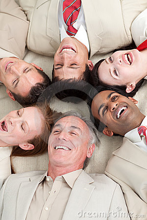 Laughing Business team lying in a circle