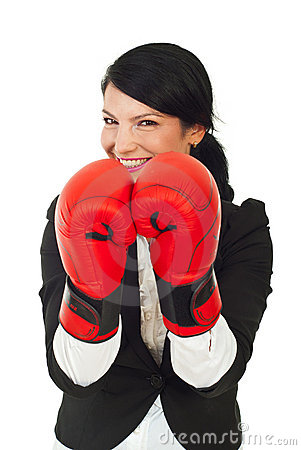 Laughing business woman with boxing gloves