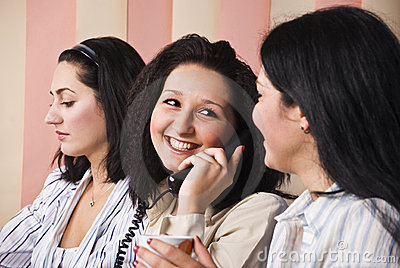Laughing business woman speaking at phone
