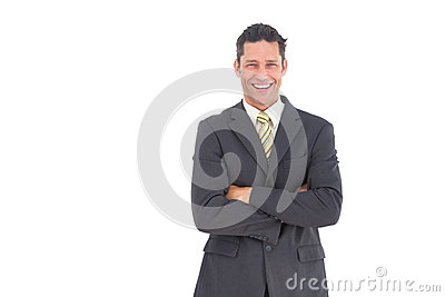 Laughing businessman with crossed arms