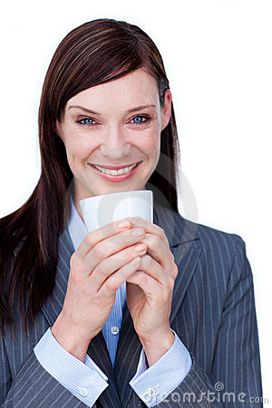 Laughing businesswoman drinking a coffee