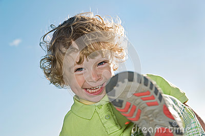 Laughing child playing outdoors