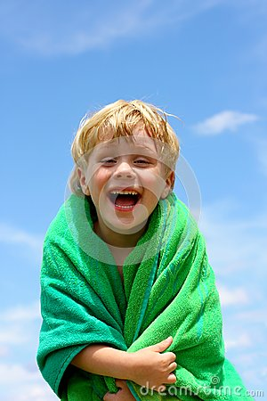 Free Laughing Child Wrapped In Beach Towel Stock Images - 31453124