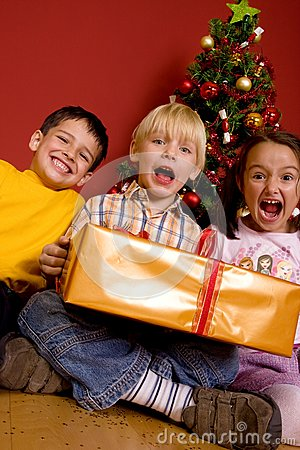 Laughing children with christmas gift