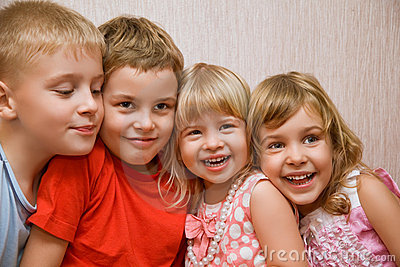 Laughing children in cosy room