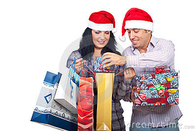 Laughing couple have fun with Christmas presents