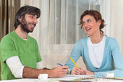 Laughing Couple Studying Together