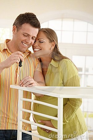 Free Laughing Couple With Baby Bed Royalty Free Stock Image - 13557816