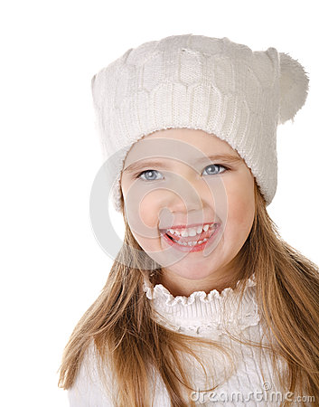 Laughing cute little girl in warm hat isolated