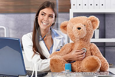 Laughing doctor with teddy bear