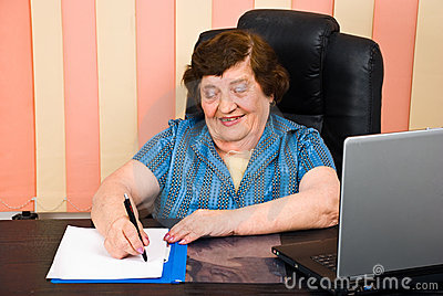 Laughing elder woman write on paper