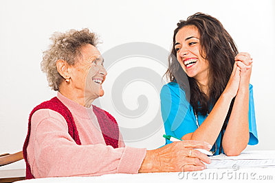 Laughing Elderly and Nurse