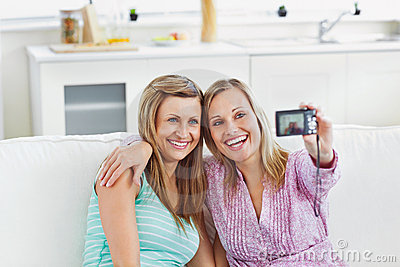 Laughing female women doing pictures of themselves