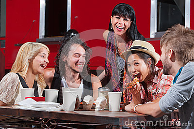 Laughing Friends Eating Pizza
