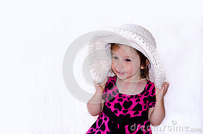 Laughing girl with big hat