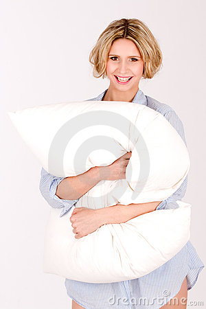 Laughing girl with pillows