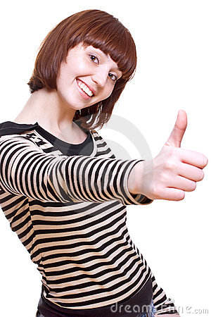 Laughing girl in a T-shirt giving thumbs-up