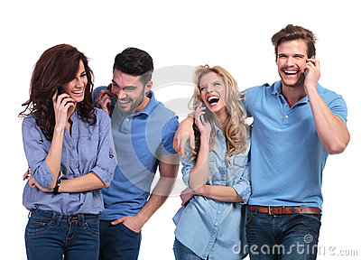 Laughing group of casual people speaking on phone