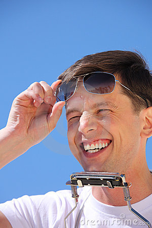 Laughing guy with lip accordion and sun glasses
