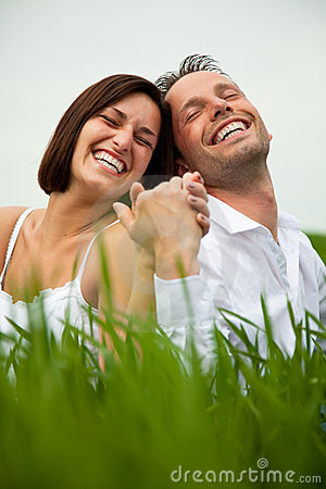 Laughing hand holding couple