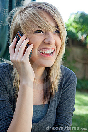 Laughing happy Teenager on Mobile Cell Phone